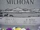 Dola E Milhoan