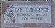 Earl L Thompson
