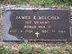 James E Belcher