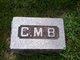 C M B