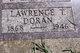 Lawrence T Doran