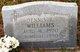 Dennis E Williams