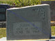 John B Thomas