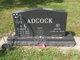 Robert E Adcock