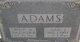 Isaac J Adams