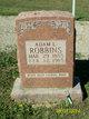 Profile photo:  Adam L. Robbins