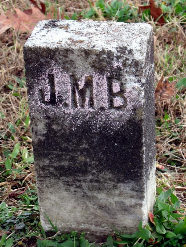 J M B