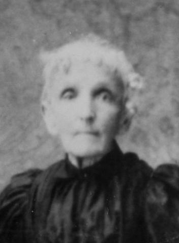 Image of woman in black dress.