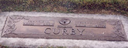 Burnell L Curby