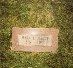 Mark L. Jewett
