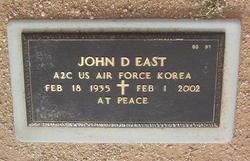 John D East