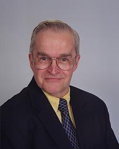 John D.  Leach