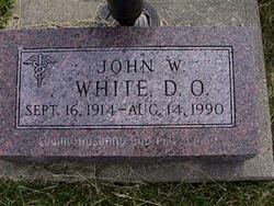 Dr John W White