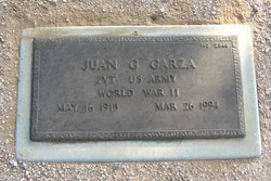 Juan G Garza