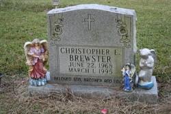 Christopher E Brewster