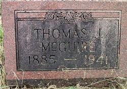 Thomas J McGuire