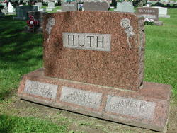 Louise J Huth