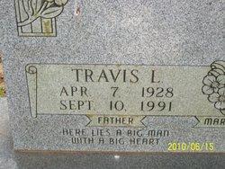 Travis L. Sims