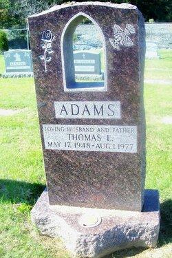 Thomas E Adams
