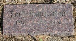 Edna M Holland