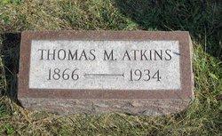 Thomas M Atkins