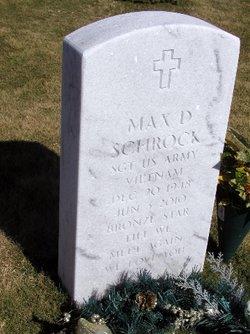 Max D Schrock