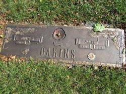 James D. Dakins