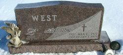 Max E. West