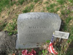 Malcolm E . Holstein
