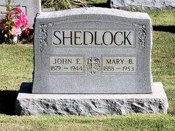 John E Shedlock