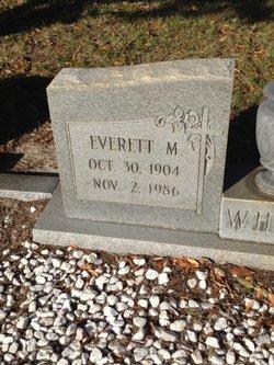 Everett M White