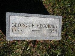 George E Mecorney