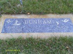 Corp Robert L Dunham