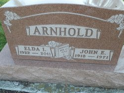John E Arnhold