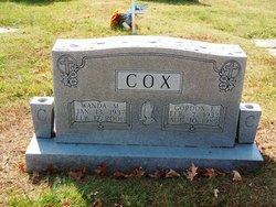 Gordon E Cox
