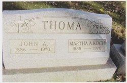 John A Thoma