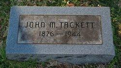 John M Tackett