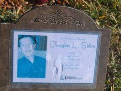 Douglas L. Selim