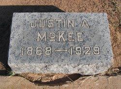 Justin A McKee