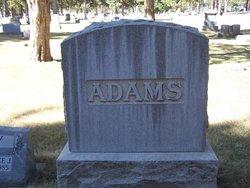 Elliot L Adams