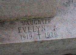 Evelyn A Barry