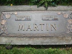 Laura E Martin