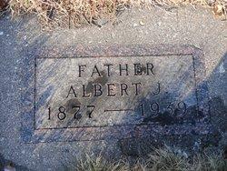 Albert J Buskey
