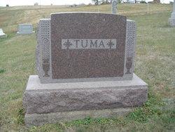 Joseph M Tuma