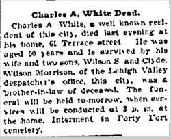 Charles A White