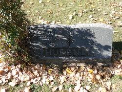 Cecil M Huebner