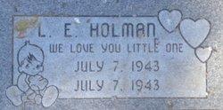 L E Holman