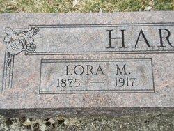 Lora M Harlan