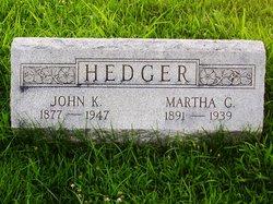 John K Hedger
