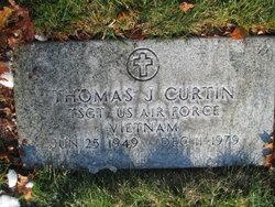 Thomas J Curtin